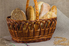 Wicker basket with bread. The grains of wheat on  woven tablecl Royalty Free Stock Photos