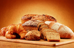 Wicker basket with bread and rolls Composition with bread and rolls. Baking products. Royalty Free Stock Image