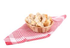 Wicker basket with bread slices on tablecloth. Stock Photo