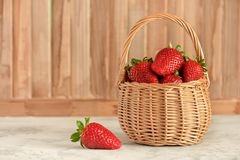Wicker Basket with Breezy Ripe Berries Side View. Natural Red Sweet Strawberries Fresh Vitamins and Organic Nutrition. Beautiful Summer Harvest Composition royalty free stock photography