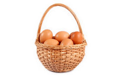 Wicker basket with brown eggs Royalty Free Stock Photos