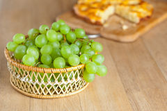 Wicker basket bunch green grapes Stock Photography