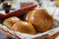 Wicker basket with buns. Wicker basket with freshly baked buns with sesame seeds Stock Photography