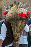 Wicker Basket Carried over the Shoulder of Countryman. Wicker Basket Filled with Sheafs of wheat and Flowers Carried over the Shoulder of Countryman Royalty Free Stock Photo