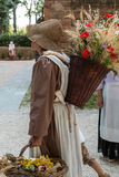 Wicker Basket Carried over the Shoulder of Young Countrywoman wi. Wicker Basket Filled with Sheafs of wheat and Red Flowers Carried over the Shoulder of Young Royalty Free Stock Photo