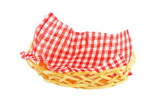 Wicker basket with a checkered napkin Royalty Free Stock Photo