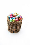 Wicker basket with chocolate eggs royalty free stock photography