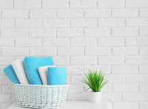 Wicker basket with clean towels. In bathroom royalty free stock photos
