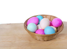 Wicker basket of colored eggs Royalty Free Stock Image