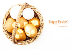 Wicker basket with colored eggs Royalty Free Stock Photo