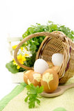 Wicker basket with colored eggs Stock Photography