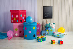 Wicker basket of colored storage and toys Royalty Free Stock Photos