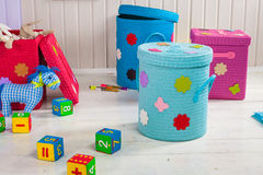 Wicker basket of colored storage and toys Royalty Free Stock Photo