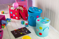 Wicker basket of colored storage and toys Stock Photos