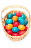 Wicker basket with colorful easter eggs Royalty Free Stock Photo