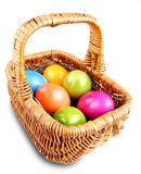 Wicker basket with colorful Easter eggs Stock Image