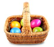 Wicker basket with colorful Easter eggs Royalty Free Stock Photography
