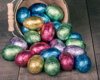 Wicker basket of colorful foil eggs Royalty Free Stock Photography