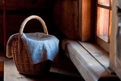 Wicker basket covered with a rough cloth Stock Photos