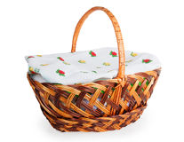 Wicker basket covered with a towel Stock Images