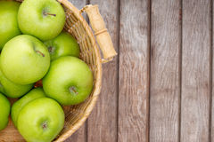 Wicker basket of crisp green apples Stock Image