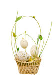 Wicker basket with decorative easter eggs. Isolated over white Stock Photo