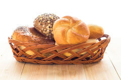 Wicker basket different types bread rolls Royalty Free Stock Photos