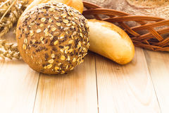 Wicker basket different types bread rolls Stock Images