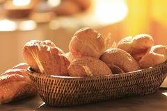 Wicker basket with different types of fresh bread table. Wicker basket with different types of fresh bread on table Stock Photos