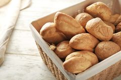Wicker basket with different types of fresh bread. On table Royalty Free Stock Photography