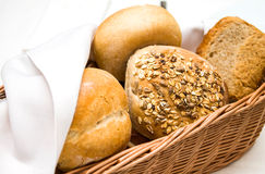 Wicker basket of dinner rolls Royalty Free Stock Image