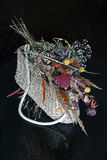 Wicker basket with dried flowers Royalty Free Stock Photo