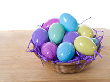 Wicker basket of Easter eggs Stock Photography