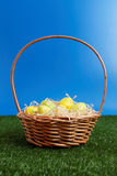 Wicker basket with easter eggs Stock Image