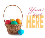 Wicker basket with easter eggs Royalty Free Stock Images