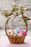 Wicker basket of easter eggs. And beautiful flowering apple branch royalty free stock photos