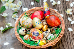 Wicker basket with Easter eggs Stock Photography