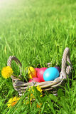 Wicker basket with Easter eggs Stock Photos
