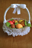 Wicker basket with Easter eggs royalty free stock image