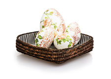 Wicker basket with Easter eggs Stock Images