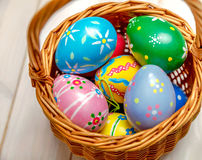 Wicker basket with easter eggs Royalty Free Stock Photos