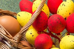 Wicker basket with eggs Royalty Free Stock Photography
