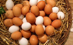 Wicker basket with eggs Royalty Free Stock Image