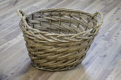 Wicker basket on elm wood Royalty Free Stock Photo