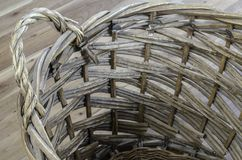 Wicker basket on elm wood Royalty Free Stock Photos