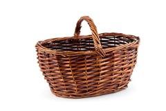 Wicker basket is empty. An empty wicker basket on white background Stock Photography