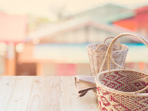 Wicker basket and fabric on  terrace pine. Stock Photo
