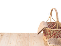Wicker basket and fabric on wooden terrace pine.  isolated on white background. Royalty Free Stock Photo