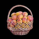 Wicker basket filled with apricots  isolated Stock Photography