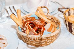 Wicker basket filled with delicious fresh rolls. stock images